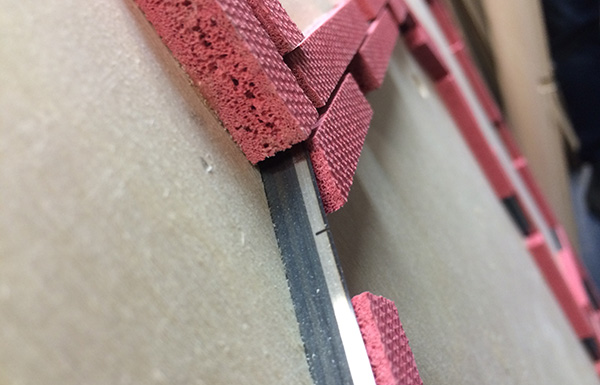 die cut close up: the metal cuts the paper, the pink padding bounces the die cut back up