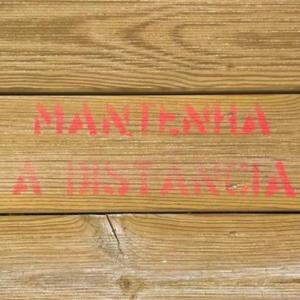 """Maintain Distance"" signage on floor."
