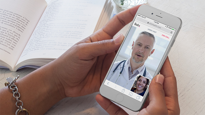 woman speaks with doctor through telemedicine